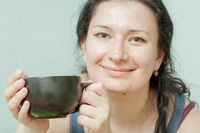 woman smiling drinking tea smile