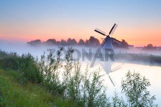 charming Dutch windmill by river