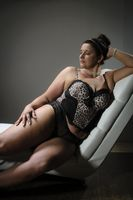 Beautiful plus size woman on white armchair