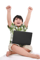 boy with laptop with moving apart his hands