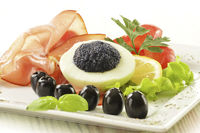 Egg with caviar and garnish