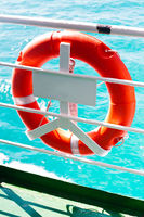Safety buoy at tourist cruise boat at blue ocean