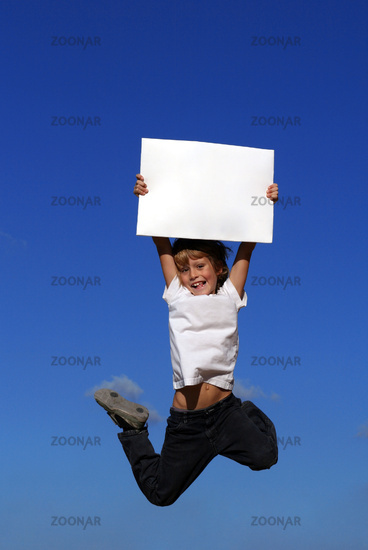 kid holding blank white board or sign