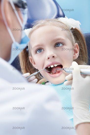Child examines the dentist in the clinic