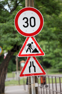 Traffic signs at a road construction site