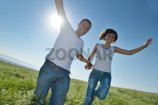 happy couple in wheat field