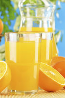 Composition with two glasses of orange juice and f