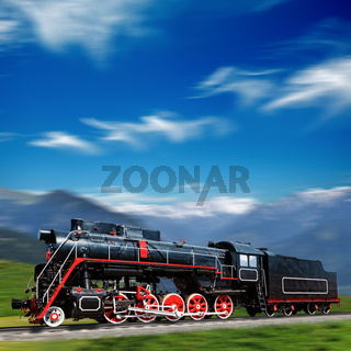 Speeding old locomotive in mountains