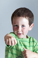 Cute Little boy playing karate