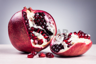granatum on table over grey background