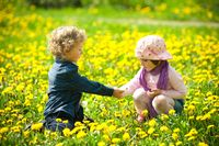 boy and girl in flowers