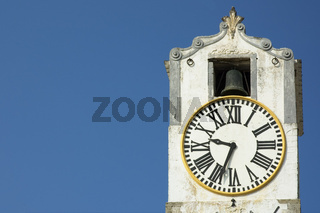 ancient clock over blue sky with space for text