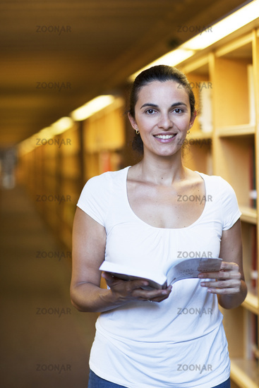 Attractive latin woman in the library