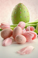 Easter eggs and pink tulips with vintage feeling