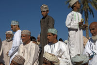 Omani men in traditional Dishdash dress, Oman