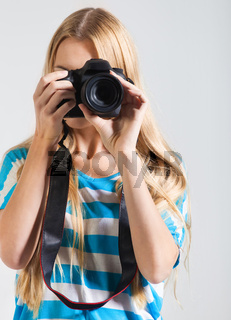 Creative woman photographer takes photos
