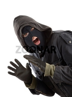 Surprised robber in a black mask
