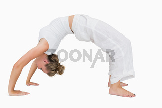 Girl in upward bow yoga pose