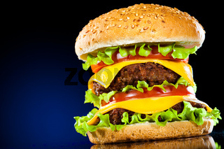 Tasty and appetizing hamburger on a dark blue