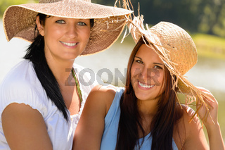 Mother and daughter relaxing outdoors summer teen
