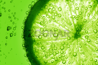 lime slice in water bubbles