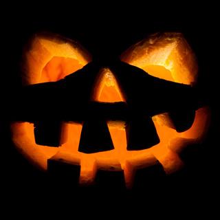 halloween, old jack-o-lantern on black
