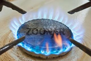 Blue flames from burner