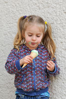 Cute little girl eating ice cream