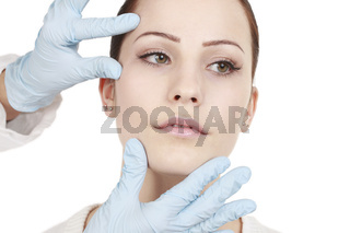 medical doctor examines the facial area before botolinumtoxin  treatment