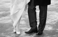 Close-up wedding shoes of bride and groom in outdo