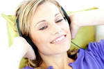Joyful woman listening to music in the living-room