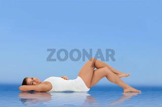 Woman lying on water