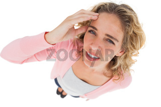 Overhead of attractive woman touching her forehead