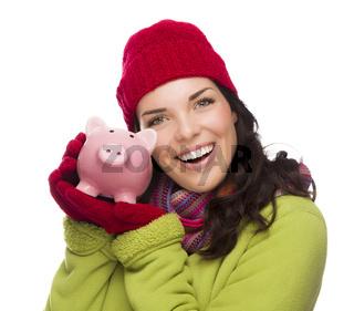 Happy Mixed Race Woman Wearing Winter Hat Holding Piggybank