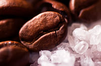Coffee beans on sugar granules