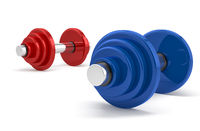 Two dumbbells over white background
