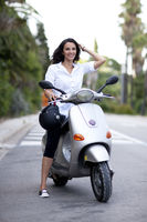 Atractive latin woman on a scooter