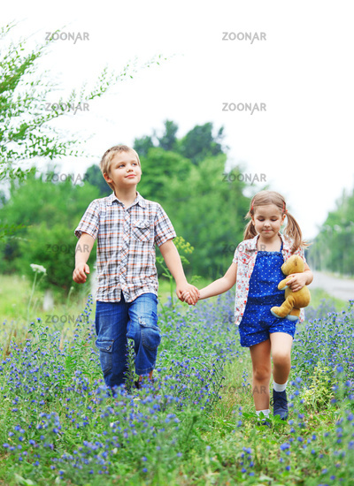 Little boy and little girl with walking