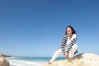 Mature woman fun ocean background