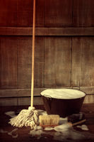 Cleaning mop and bucket with wet soapy floor