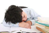 adorable boy tired to study