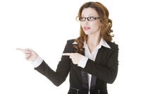 Happy success businesswoman pointing