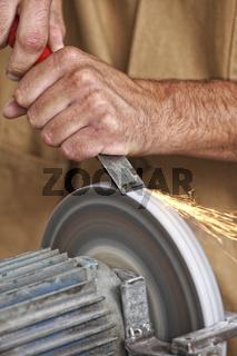 manual worker sharp his tool