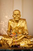 Gold buddhist monk statue in temple