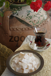 A glass of Turkish Tea and a bowl of Turkish Delight. ( Loukoum )Sultanhamet