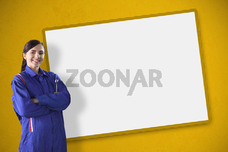 Female mechanic standing in front of a blank screen
