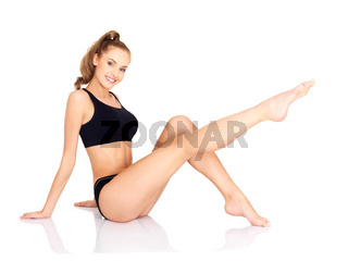 Pretty young woman doing fitness