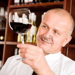Wine bar waiter looking at glass restaurant