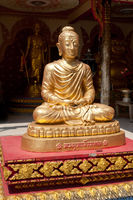 Golden statue of Buddha in meditation. Thailand