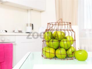 Green apples on the  white kitchen